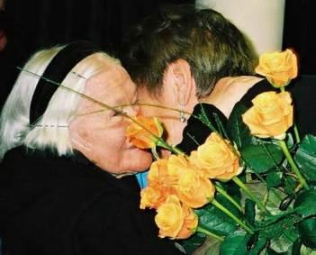 Elzbieta Ficowska and Irena exchange a hug after the November ceremony.