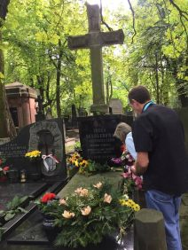 Placing flowers on Irena's grave