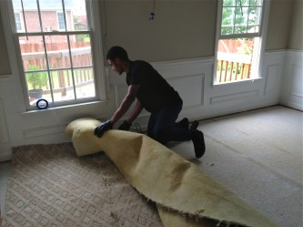18-year old grandson disposing of old carpet