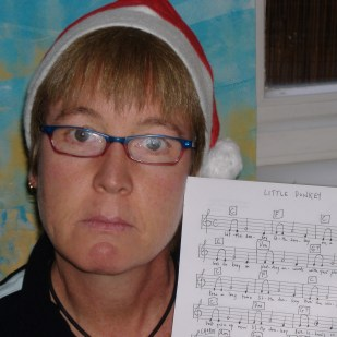 Advent Calendar Day 3, 3rd December. Artistic Director Sara prepares mentally to give a rendition of Little Donkey, and she definitely means business.