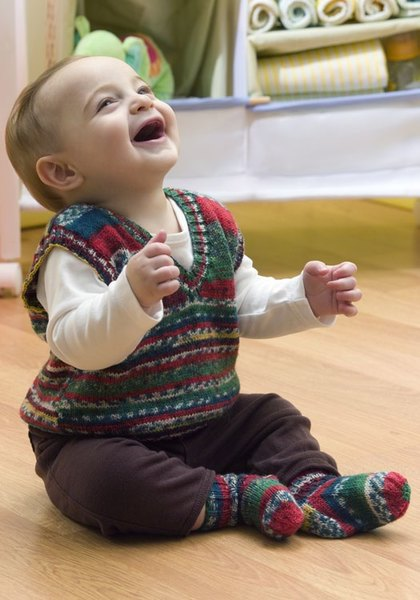Baby Holiday Vest Crochet Pattern from Red Heart Yarn  FaveCraftscom