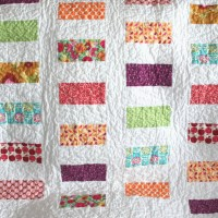 Colorful Coins Baby Quilt Pattern | FaveQuilts.com