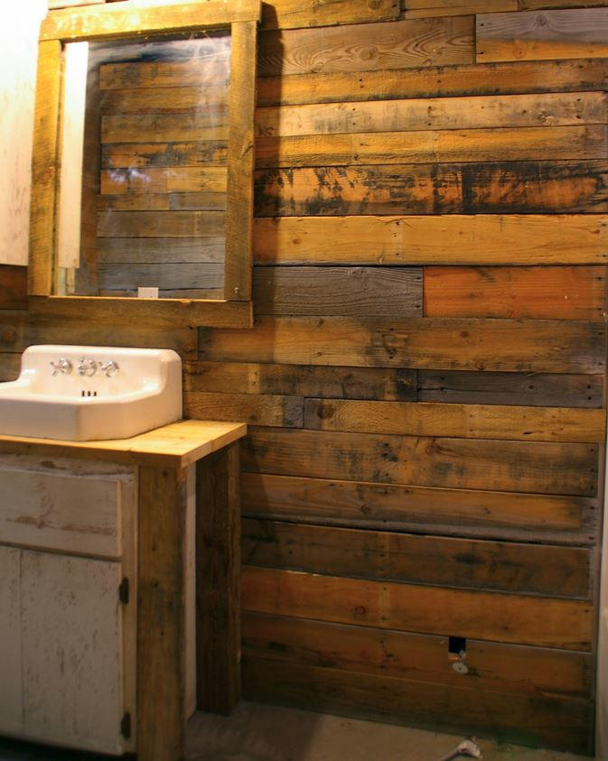 kitchen cleaning products drawer liners covering walls with pallet wood | diyideacenter.com