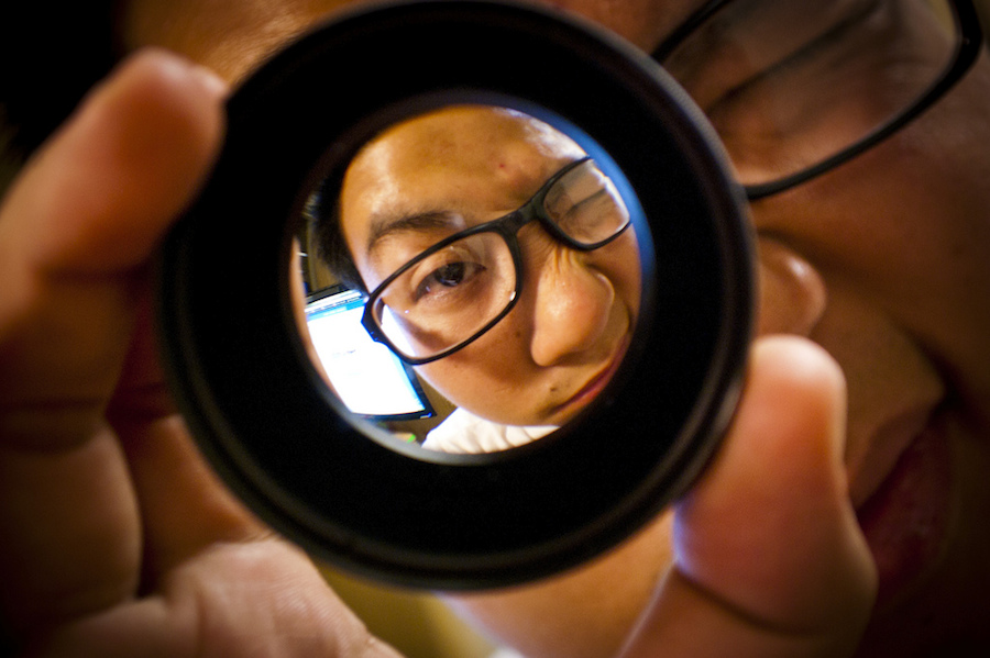 person looking through a lens