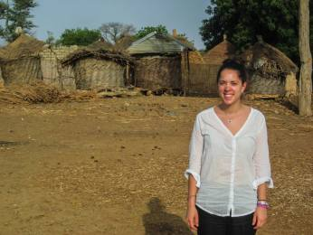 Columbia graduate student Catherine Pomposi standing in front of the millet-storage huts in Fatick, Senegal. Pomposi is advised by IRI Research Scientist Alessandra Giannini.