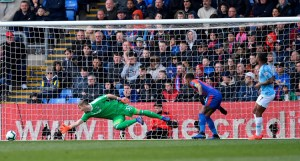 Raheem Sterling scored twice to inspire Manchester City to 2-1 win over Crystal Palace