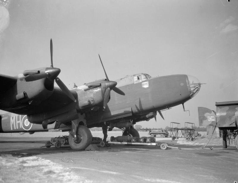Bombs being loaded onto a Halifax of 51 Squadron at RAF Snaith (Imperial War Museum CH11622)