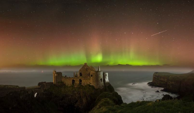 Aurora over the Dunluce Castle ruins - visit Ireland