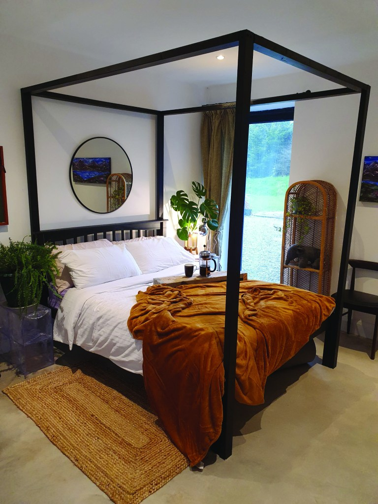 The finished transformation of the bed into a four poster
