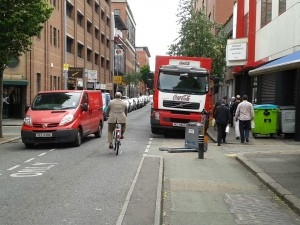 A Coca-Cola branded truck blocking a two-way cycle path in Belfast
