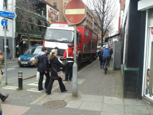 Another Coca-Cola branded truck, this time with traffic wardens ticketing it