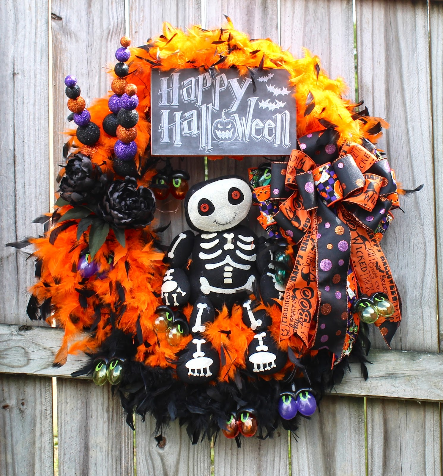 adorable skeleton and spooky eye lights feather boa happy halloween wreath