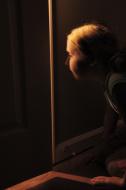 stock-photo-10395897-girl-peeking-through-cracked-door