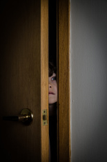 stock-photo-65631363-boy-peeking-through-closet-door-with-fear