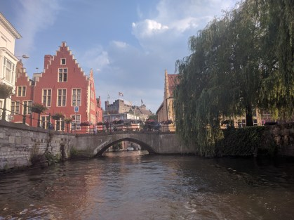 Canals of Ghent. Our Airbnb was in the yellow house behind the tree.