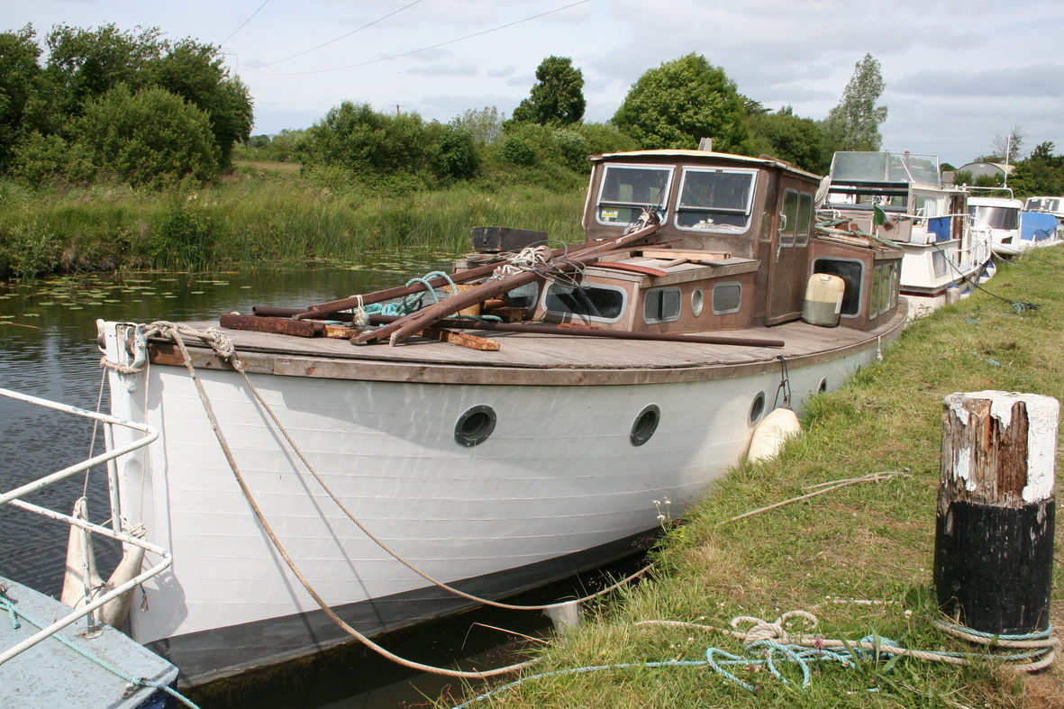 Unidentified wooden boat at Shannon Harbour June 2009. Being renovated. Nice lines. I wonder what it was originally