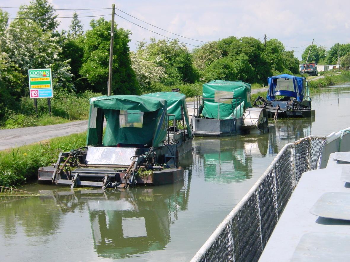 Three weed-boats