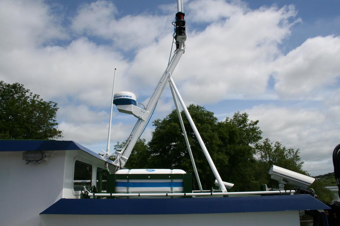Radar. Is that a liferaft below the mast tripod?