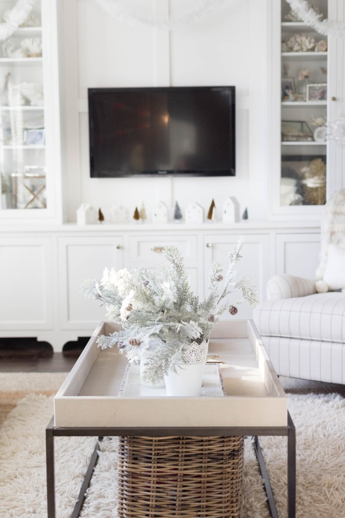 cozy winter living room coffee table decor-bohemain-glam-christmas-home-tour-iris-nacole-living-room-tour