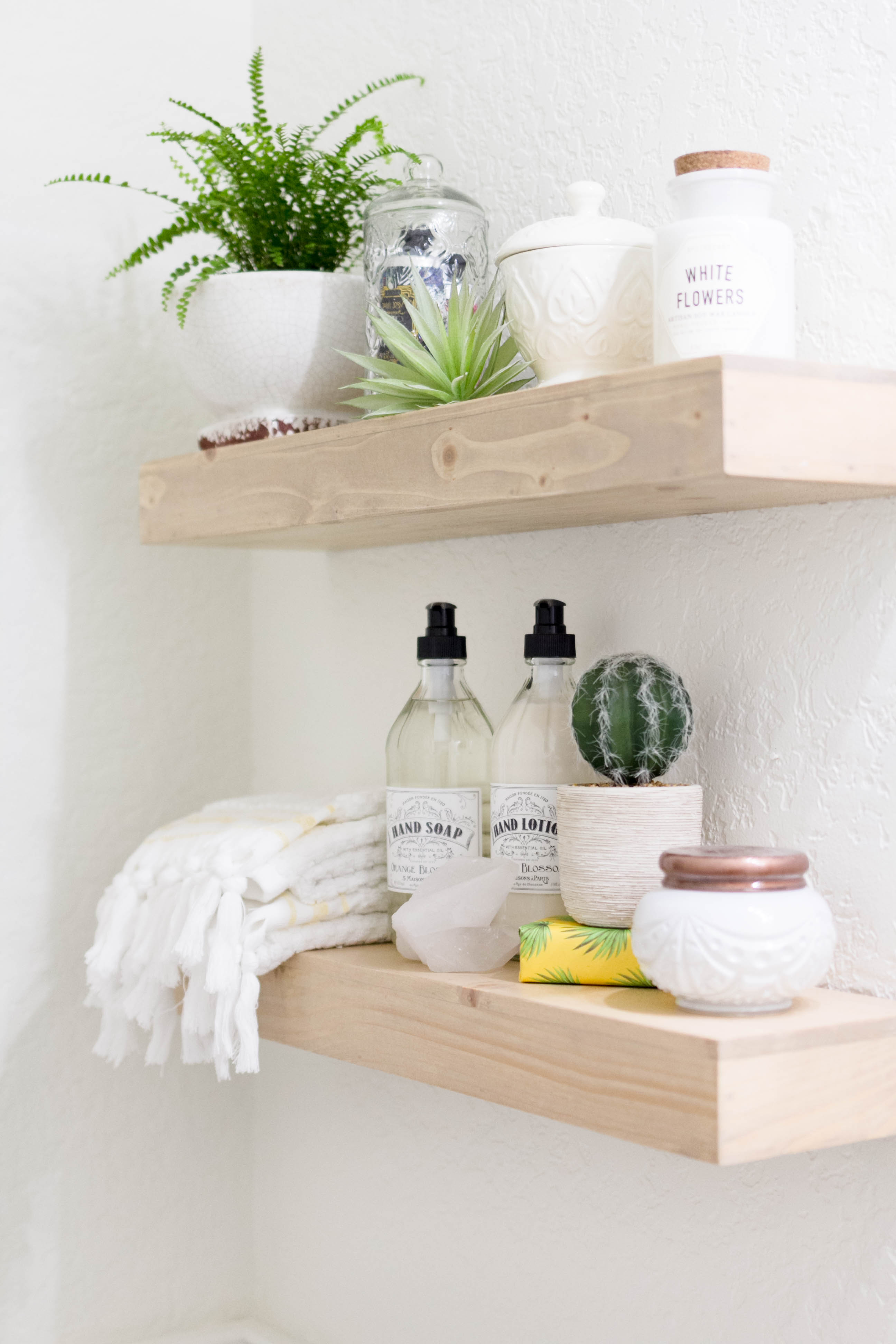 Floating Shelf Styling in a bright and welcoming mudroom/powder room combo with a modern-casual-beach feel. Designed by: IrisNacole.com