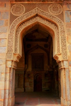 An arch in the mosque replete with fine caligraphic engravings.