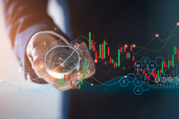 Abstract, A businessman holding a compass to navigate the business with marketing of icons and business growth graphs, Stock market and data exchange.