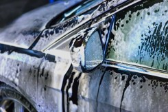 car covered with foam on car wash