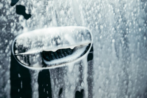 car in foam on carwash