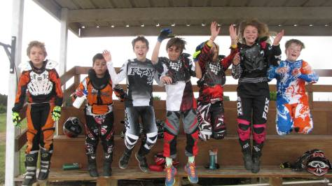 Excited, jumping motorcycle campers