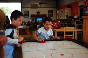 Playing Air Hockey Games