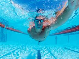 Ironman passing you by  -triathlete in swimming pool