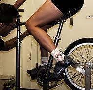 ironman bike fit. A bike shop expert fitting a cyclist for his bike