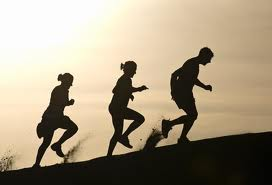 triathlon run training tips  -two female and a male runner hill training