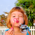 Cute Girl Blowing Soap Bubbles Products and Gifts