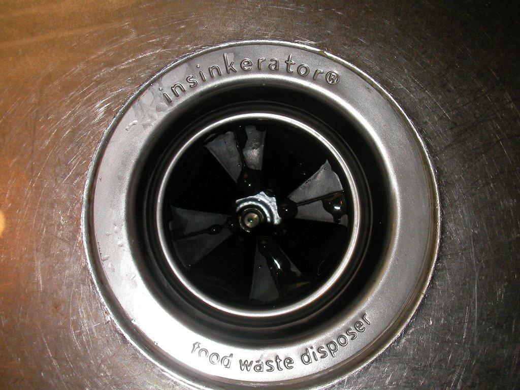kitchen sink disposal tile home depot garbage tips north texas custom plumbing