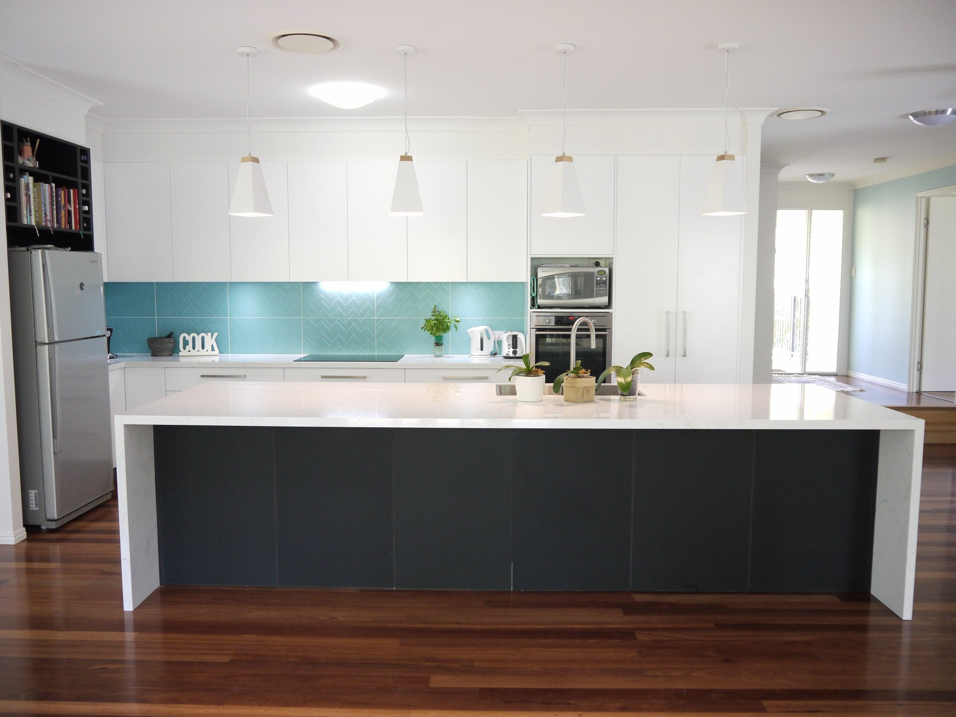modern white kitchen cabinets wood top island & black with a turquoise pop!