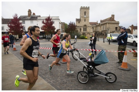Mum Jessica Bruce 32 breaks the world record for running a marathon in 3 hours 17mins and 52 seconds at the Abingdon marathon pushing her 7 month old baby Daniel.