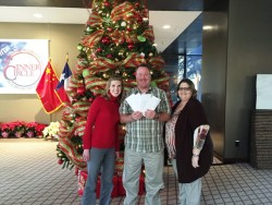 Kyle Taylor of Irving Cares with NCH employees displaying their cash donation on Dec. 17, 2015