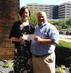 David Cole presents the i Fratelli donation to Heather Newell