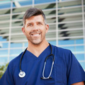 demo-attachment-57-smiling-male-healthcare-worker-outside-hospital-resized
