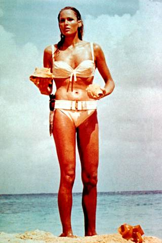 The first-ever Bond girl, Swiss Ursula Andress, in the classic scene of Dr. No.