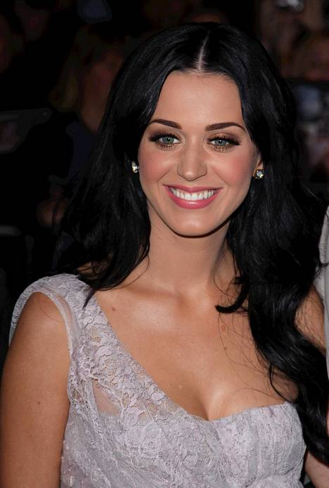 Katy Perry enjoys blonde hair these days, but as dark-haired, she sometimes believed people to be Zooey Deschanel.