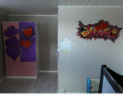 In addition to the paintings, there were holes and screws in the walls of the bedroom.