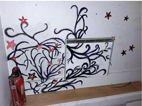 Both the wall and the radiator had been painted.