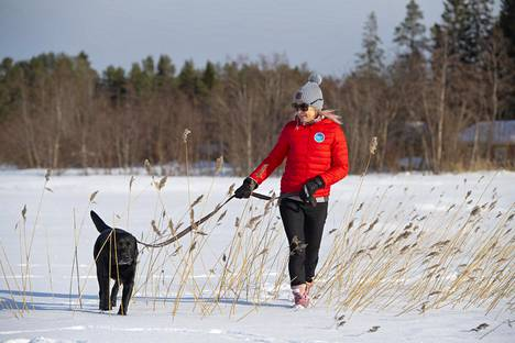 Riitta-Liisa Roponen and the Ibra dog, which is very comfortable in Finland.  Denver's mountain air froze Ibra's jogging fortune.