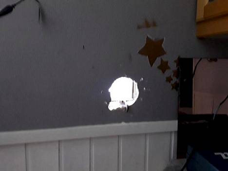 There was a big hole in the kitchen wall.