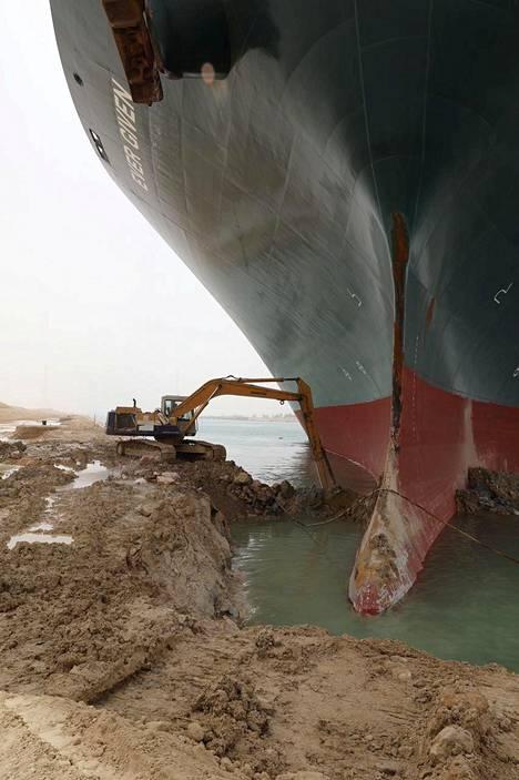 Excavators have dug up ground around the ship's bow thruster.