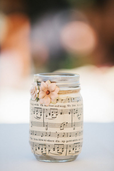 mason jar decorated with sheet music and a flower