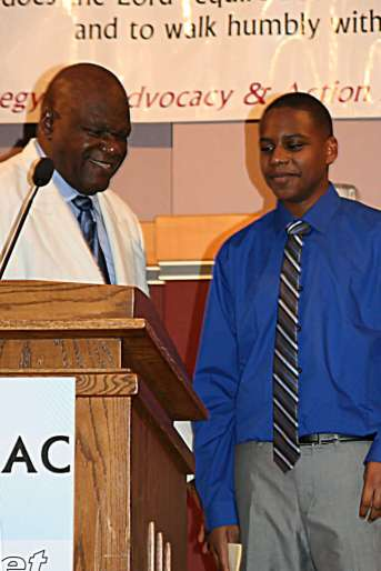 Rev Rick Tyson and Parishioner
