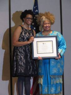 "Dr. Charlae Davis presents Ms. Venessa Collins-Smith with ISAAC Leader of the Year Award for creating ""Future Leaders for Peace"" as part of ISAAC's work on Youth Violence Prevention."